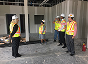 The VISN 16 Network Director receives an update on construction progress, at the Lake Charles Veterans clinic.