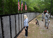 Dr. Skye McDougall, VISN 16 Network Director, honors those names listed on the Vietnam Traveling Memorial Wall. The Travelling Wall was a special addition to the 15th Trail of Honor, in Jackson, Mississippi.